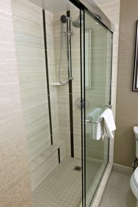 shower and shower doors with a nude colour tiling